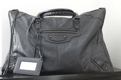 I just love this Balenciaga weekender.