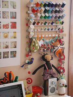 I like the slanted spool rack...would keep the spools and bobbins from falling off. I would store matching spools and bobbins together.