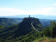 "Almost two hours from Rome, Civita di Bagnoregio -- Italy's ""Jewel on the Hill"" -- rises up from the surrounding hills, a majestic sight on the skyline. Though the view is sublime, there's one problem rocking this isolated, ancient town. Italian News, Beautiful Landscapes, Monument Valley, Rome, To Go, Skyline, Italy, Mountains, World"