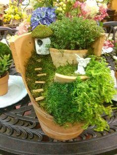 broken pottery planters | Fairy garden out of a broken clay pot