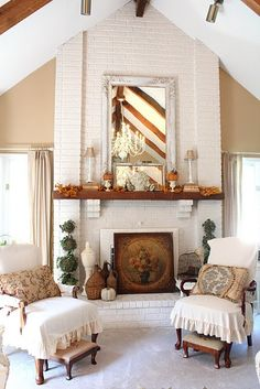 New Photos two story Brick Fireplace Style those chairs are the worst. and the topiaries. but look! a big white painted fireplace White Painted Fireplace, Paint Fireplace, Fireplace Ideas, Mantle Ideas, Fireplace Mantles, Tiled Fireplace, Fireplace Makeovers, Brick Fireplaces, Fireplace Decorations