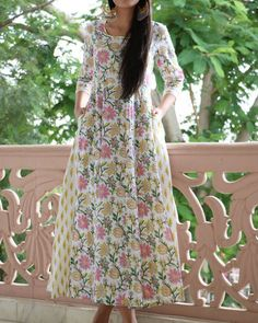 Shop online Floral flared maxi Floral block printed maxi with attached side panels. The wide flare on the maxi adds to its charm. Modest Dresses, Simple Dresses, Maxi Dresses, Girls Dresses, Simple Kurta Designs, Cotton Dresses Online, Indian Designer Suits, Indian Suits, Indian Attire