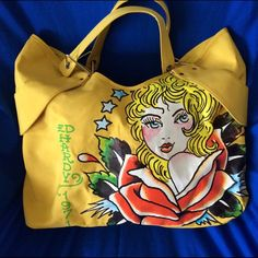Ed Hardy vinyl shoulder bag Ed Hardy vinyl shoulder bag. Used a few time in great condition no stains inside or out. Non smoking house. Ed Hardy Bags Shoulder Bags