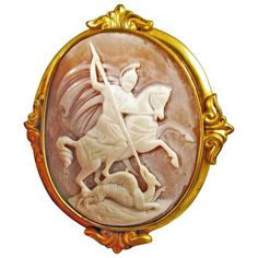 Antique Victorian Saint George and Dragon Gold Cameo Brooch    From a unique collection of vintage brooches at https://www.1stdibs.com/jewelry/brooches/brooches/