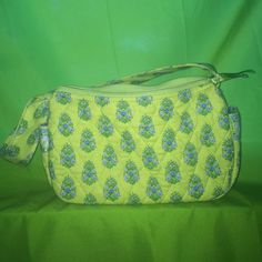 Vera Bradley one shoulder hand bag One shoulder hand bag. 2 pockets on the inside, two on the outside on either end. Light greenish yellow pattern, light blue on inside. Vera Bradley Bags Shoulder Bags