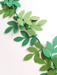 garland of flowers Paper Eucalyptus Garland. 50 leaves strung on 5 feet of dark green cotton yarn. Punched Eucalyptus leaves are alternating in two colors: Olive & Hun Paper Flowers Diy, Diy Paper, Paper Art, Boho Wedding Decorations, Bachelorette Party Decorations, Bachelorette Banner, Garland Wedding, Wedding Ideas, Garden Decorations
