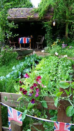 Vegetable patch - Love this, especially the sweetpeas at the end or beginning of the rows. I can even live with the Union Jacks but they wouldn't be my first choice. S