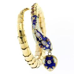 View this item and discover similar for sale at - A splendid coiled snake blue enamel bracelet. The gold snake has f flexible scales and a body accented with blue and white enamel, red Ruby Enamel Jewelry, Gold Jewelry, Jewelry Bracelets, Fine Jewelry, Jewellery, Reptiles, Snake Bracelet, European Cut Diamonds, Heart Jewelry