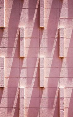 Pink architecture and stucco texture in shadows.