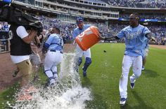 Kansas City Royals' Salvador Perez (13) managed to dodge the celebratory dousing by Jarrod Dyson (1) and Drew Butera (9) after the teams 4-3 win over the Texas Rangers during Sunday's baseball game on June 7, 2015 at Kauffman Stadium in Kansas City, Mo.