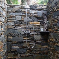 for the master shower - ledger stone veneer is an alternative to  tile (as for an outside shower as depicted - you'd want to add a heavy gauge screen on top - no one wants to shower with SPIDERS or other insects - ew