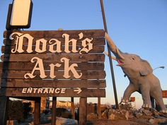 """""""Noah's Ark"""" sign - photo by Todd Franklin (Neato Coolville), via Flickr;  Noah's Ark Restaurant has been closed for some years now. Noah's animals still guard this roadside wonder! It's located on I-70 in St. Charles, MO.  (2004);  According to one of the comments, the restaurant has now been demolished but the animals are being incorporated into a new fitness center's design somehow."""