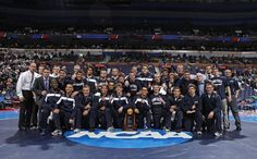 17 MAR 2012: The University of Penn State wrestling team is awarded the team championship trophy after the Division I Men's Wrestling Championship held at Scottrade Center in St. Louis, MO.  Mark Buckner/NCAA Photos
