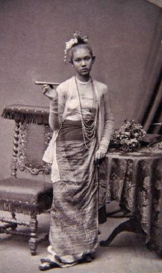 "Burmese lady with a cigar.  ""Frau mit Zigarre"" c. 1875. Portrait by the German ethnologist and explorer Fedor Jagor who was in Rangoon collecting for Berlin museums."