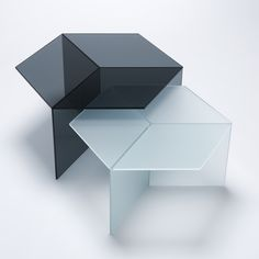 Isom: The Isom tables play with an intriguing optical illusion. Made from hexagonal tops resting on three squares, their edges form diamond-shaped surfaces that, when viewed from certain angles, form a perfect isometric representation of a cube.