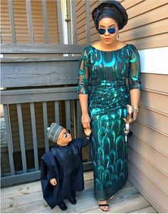 This mother and son duo are too cute, stylish and on trend, love it. #mother #son #Nigerianfashion #fashionistas #stylishduo #beautiful #awwww #gorgeous #sunglasses #makeup #gélé #loveit #nigerian #African #green #fílá #ágbádà  #accessories #earrings #bracelet #clutch #guinea #cap #fashion #style #shoes #cutenessoverload #toocute #headtie #littleprincess #Queen #slayed