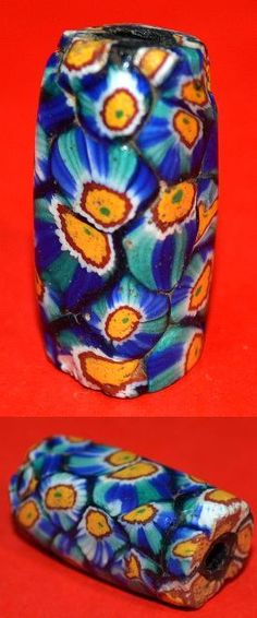 One square antique Venetian made millefiori glass bead collected from Africa. Exhibiting rare cane patterns.