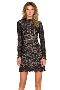 $305, revolveclothing.com Get the illusion effect with black lace and nude lining. Triangular cutouts on the back make this For Love & Lemons dress a fun choice for your next party.   - BestProducts.com