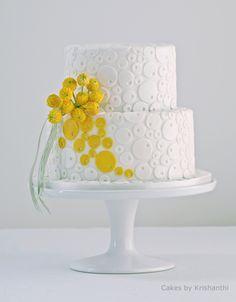 Whimsical wedding cake by http://cakesbykrishanthi.co.uk