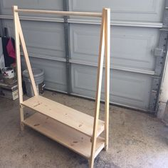 DIY: Kids Wood Clothing Rack - This Bliss Life <br> Need a space for dress up clothes or costumes? Learn how to build a kids wood clothing rack otherwise known as an open wardrobe! Diy Clothes Rack Wood, Wood Clothing Rack, Kids Clothing Rack, Clothes Racks, Diy Clothes Storage, Diy Clothes At Home, Retail Clothing Racks, Diy Clothes Closet, Clothing Organization