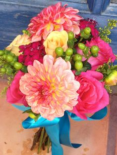 Jr. Bridesmaid bouquet using pink roses, green coffee bean, orange roses and pink dahlias.