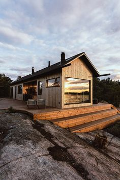 the cabins of project ö make reference to traditional finnish archipelago aesthetics with gabled roofs, deep eaves and vertical timber cladding. Timber Cabin, Timber House, Tiny House Cabin, Cabin Homes, Log Homes, Summer Cabins, Modern Barn House, Small Modern Cabin, Small Cabins