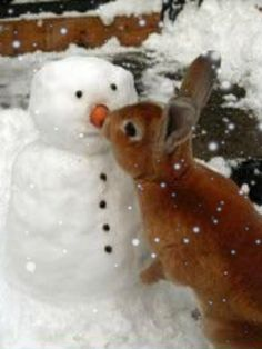 Picking the snowman's nose.