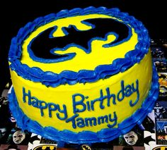 Cream cheese frosted Itallian cream cake. The birthday girl requested a BRIGHT yellow & blue frosting. The Batman symbol was was hand cut from black fondant.