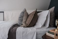 We updated Jack's bedding and added in some extra layers for the cooler weather. Here's some of my favourite tips to use when styling a bed. Green Pillow Covers, Green Pillows, Duvet Covers, Throw Pillows, Textures And Tones, Subtle Textures, Beautiful Textures, Linen Duvet, White Houses