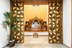 Edgy yet Graceful: Family home in Ahmedabad Apartment Interior, Interior Design Living Room, Temple Design For Home, Pooja Room Door Design, Green Interior Design, Room Partition Designs, Puja Room, Ceiling Design, Scandinavian Design