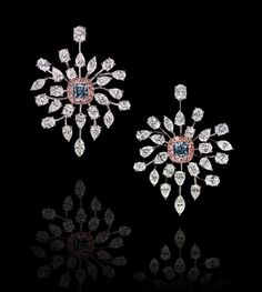 Fancy Intense Blue, Pink and White Diamond Earrings totaling 24.02 carats, handcrafted in platinum and 18 karat rose gold