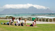 Exercising in front of table Mountain in Cape Town, South Africa - Fitness package in Cape Town for those of you hooked on fitness #kilroy #travel #africa