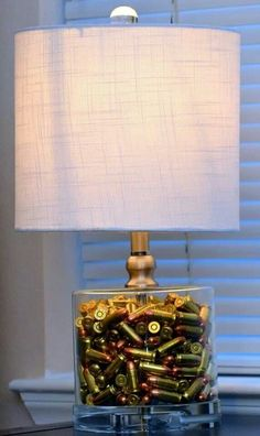 """""""Shot gun shells"""" um def not shotgun shells. It's a cool lamp though For the office! And yeah, the previous pinner is right-- those aren't from a shotgun lol! Redneck Crafts, Ammo Crafts, Bullet Casing Crafts, Bullet Crafts, Shotgun Shell Crafts, Shotgun Shells, Gun Decor, Bullet Shell, Bullet Art"""