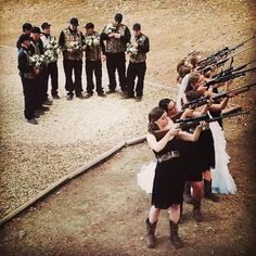 "Country camo wedding with guns!! love everything about this picture.. outfits and ""picture"""""