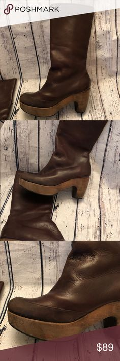 Anthropologie Coclico Boots Leather $545 8 38 Clog Woman's Coclico Mid calf boots. Size 38 (US 8) Brown, high quality pebbled leather Wooden, clog like bottoms, bottom rubber protected to keep you from slipping. Shoes in good used condition. A few scratches, typical with useage. Nothing abused about them. Side zip ups for easy slip on and off. No weird smells or feet odors. Boots have been cared for. Anthropologie Shoes Heeled Boots