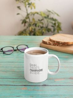 """Love this """"Shhh... There's Champagne in Here"""" funny mug?  We do too :)  Its the perfect cute gift idea for moms, dads, best friends, co-workers, teachers, women, men or even yourself...    #funnymug #giftideas #funnycoffeemug #giftideasforfriends  #KatieMcGrathDesigns Funny Coffee Mugs, Coffee Humor, Funny Mugs, Cute Gifts, Best Gifts, Standard Coffee, Pregnancy Gifts, Novelty Gifts, Gifts For Husband"""
