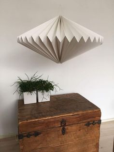 Origami Lampshade, 12 different designs. Available at https://www.lampionwebshop.nl/decoratie-papier/origami-lamp