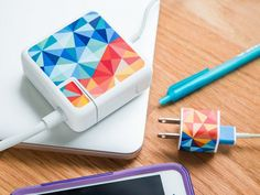 Charger stickers, discovered by The Grommet, with a funky geometric print that helps your charger stand out with personality.