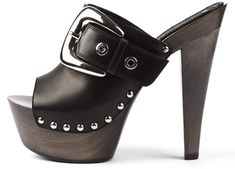 Gianmarco Lorenzi black leather clogs with large silver buckle.