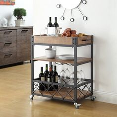With an ample top tray and perfectly positioned wine glass inserts, the Seymour Kitchen Serving Cart from Verona Home is ideal for entertaining at home. This beautiful cart has a weathered patina that allows traces of the natural wood to show through.