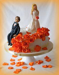 small wedding cake with orange roses