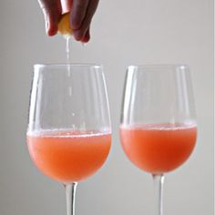 A rum cocktail topped off with orange juice, grenadine, lemon, and champagne, inspired by the small Caribbean island of Mustiqe.