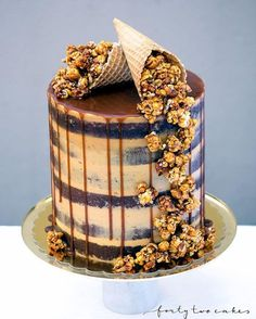 Salted caramel overload for your Friday enjoyment  Six layers of seminaked vanilla bean and white chocolate cake +  salted caramel Swiss meringue buttercream + salted caramel drip + a cascade of crunchy salted caramel and roasted peanut popcorn. Not for the faint hearted  Cake stand: @tomdixonstudio