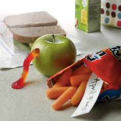 April fools: a wormy apple, stubbornly unzippable ziplock and a switched snack will crack up little diners at lunch time.