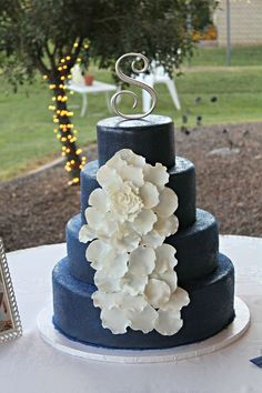 Design was from a cake on pinterest that was given to me by the bride. Navy blue with sugar crystals and white cascading flower.