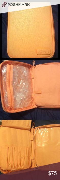 Laura Mercier cosmetic organizer Light melon color never used has slight discoloration on the back from storing next to a darker colored organizer. See last photo for details. Laura Mercier Bags Cosmetic Bags & Cases