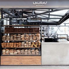 bread shop Lauras is a chain of gourmet bakeries. The design draws on the nostalgia of grandmothers cakes and bread, integrated with the combination of a modern metropolitan vibe with a minimalistic Scandinavian aesthetic. Bakery Shop Interior, Bakery Shop Design, Kiosk Design, Cafe Interior, Cafe Design, Design Design, Store Design, Bakery Display Case, Bread Display