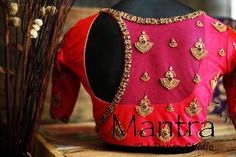 Contemporary redefined at Mantra design studio . Stunning pink color designer blouse with chaandbali design hand embroidery gold thread and zardosi work. Blouse with side key hole design. For Wedding Trousseau enquiries call on 13 April 2019 Pattu Saree Blouse Designs, Designer Blouse Patterns, Fancy Blouse Designs, Bridal Blouse Designs, Blouse Neck Designs, Zardosi Work Blouse, Sari Blouse, Saree Dress, Mantra