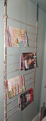 old crib rail as magazine rack