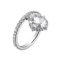 A truly unique piece, the June Ring is one of our favorites. The 1.6 carat oval rose cut diamond lies in an offset, fully paved, claw prong platinum setting wit